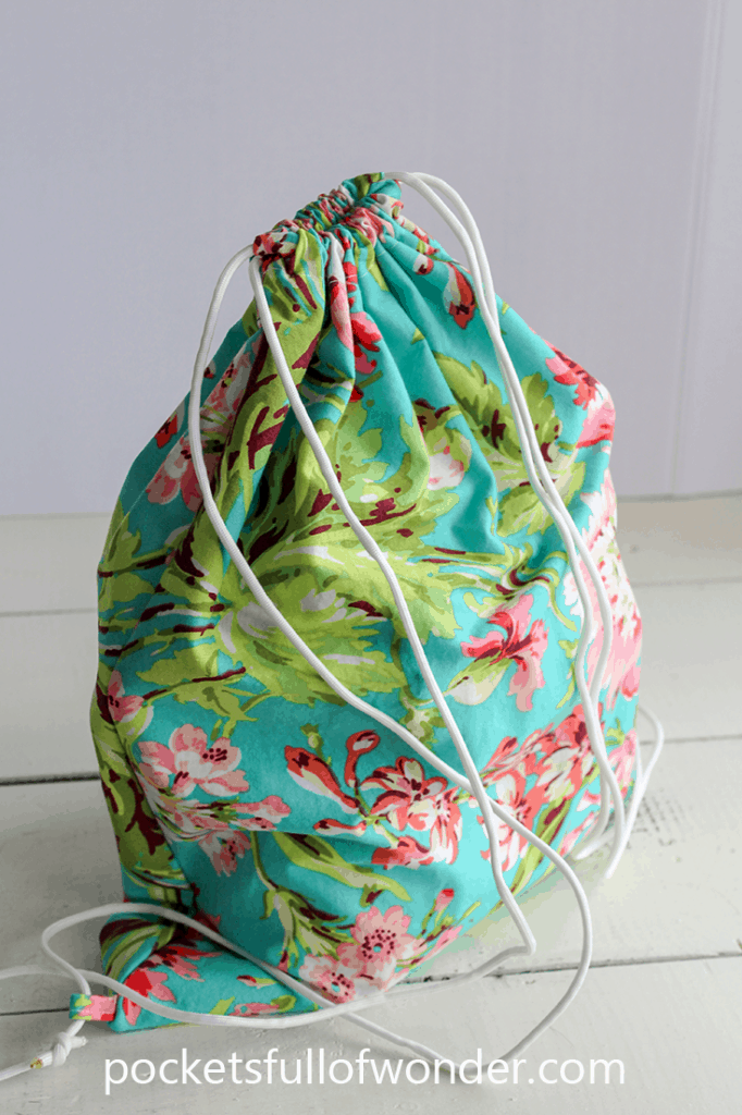 Super easy drawstring backpack tutorial, complete with pictures of each step.