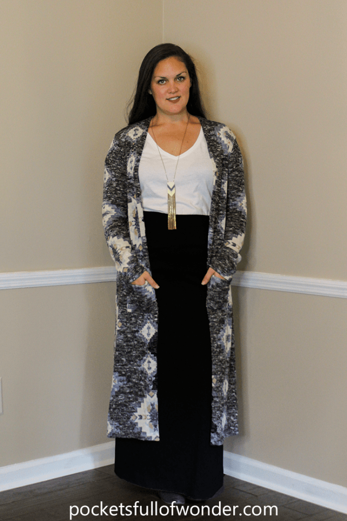 Black Maxi Skirt with White T-Shirt, Patterned Duster Cardigan, and Pendant Necklace