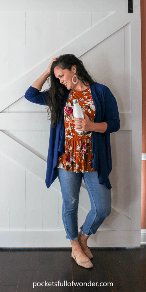 Cute Spring Outfit: Floral Top, Distressed Jeans, Light Cardi, Ballet Flats, and Statement Earrings