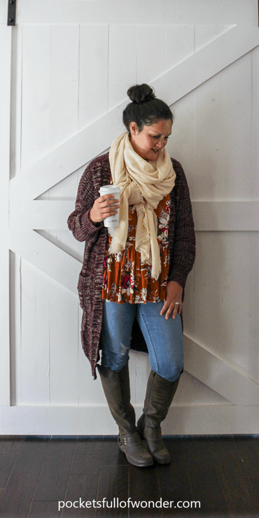 Cute Winter Outfit: Floral Top, Distressed Jeans, Over-sized Cardigan, Tall Boots, and Blanket Scarf