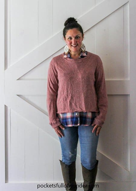 Fall Outfit Idea with a Plaid Shirt, Coordinating Pullover, and Distressed Jeans