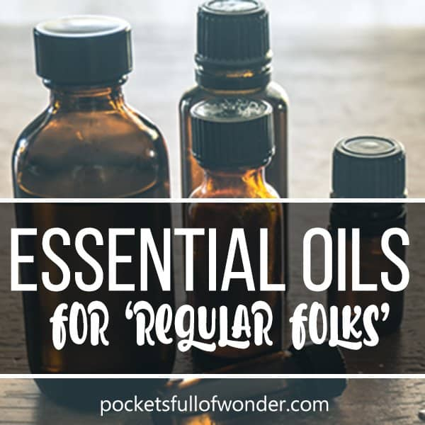Essential Oils for 'Regular Folks' (small group of unlabeled essential oil bottles with text overlay)