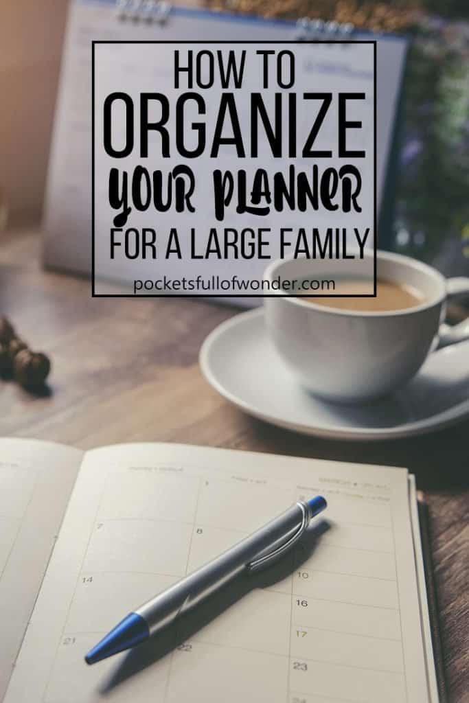 Photo: Planner on desk with coffee mug and calendar // How to organize your planner for a large family #planner #organization #commandcenter #planneraddicts
