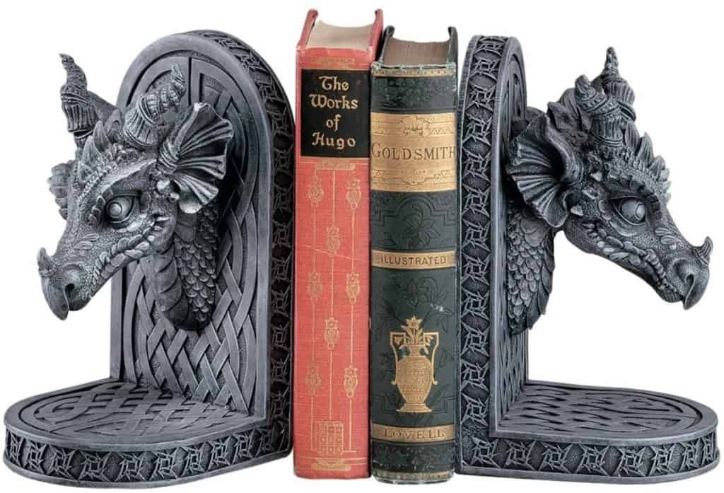 Intricately detailed faux stone dragon head bookends.